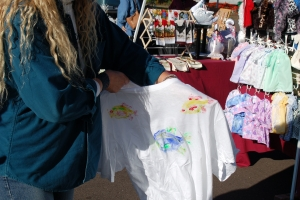 Woman Showing T-Shirt with Custom Fish Stamps